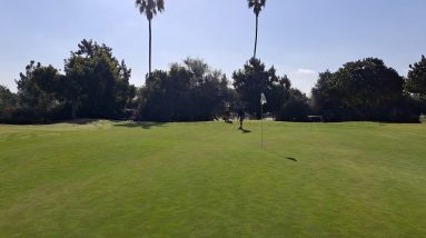 Putting with beginning golfers walking in your line